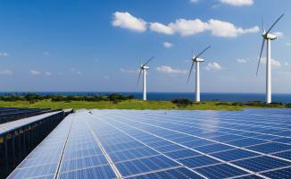 Photo of solar panels and wind turbines